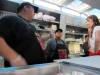 Don Chow chef/owner Dominic Lau discusses tacos with a rep from Dos Equis