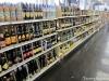 Shelves of beer run into shelves of wine