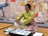 A shortened Korean women's tea ceremony on IOTA's patio