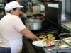 Our chef prepares pupusas at La Nueva Flor Blanca