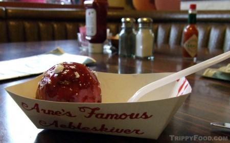 A freshly made jam-coated æbleskiver from Solvang Restaurant