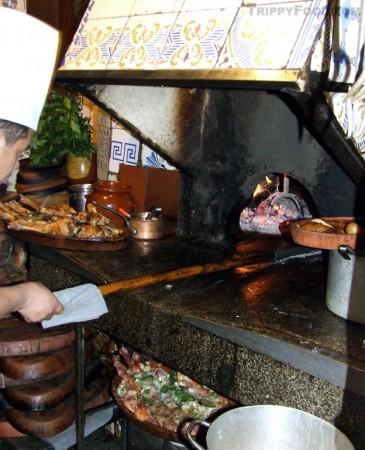 Roasting suckling pig in the original 1725 oven