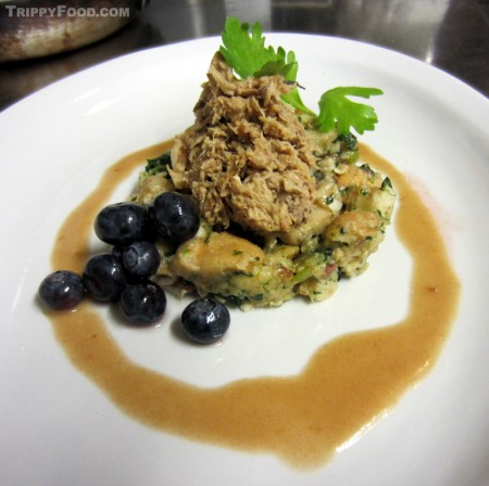 The plated nutria with Rockefeller dressing