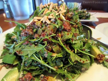 An arugula-heavy quinoa salad