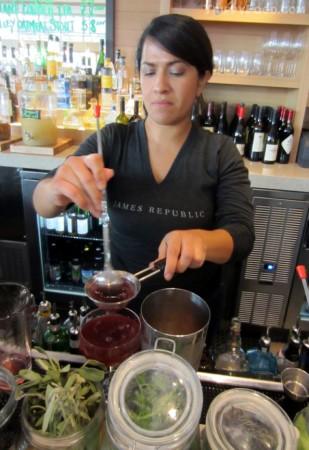 Bartender Pamela Trujillo using fresh ingredients for libations