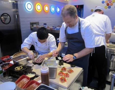 Executive Chef Jeffrey Lunak prepares an ahi dish